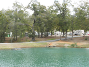 Fair Harbor RV Park and Campground Across the Lake Photo