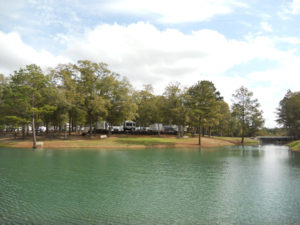 View across the lake at Fair Harbor RV Park and Campground